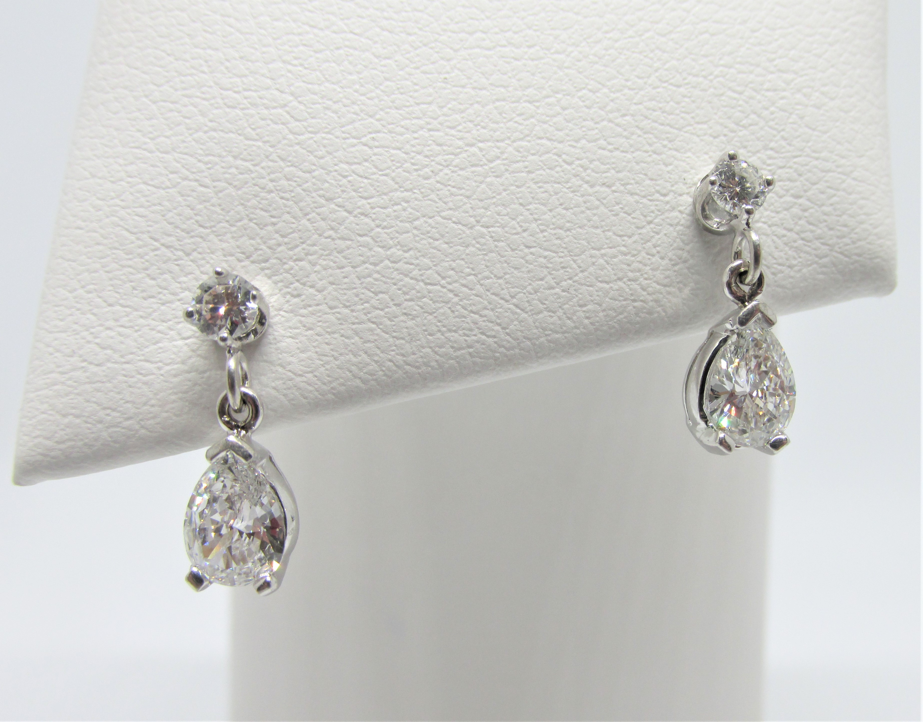 14kwg Dangle Earrings With 2 Pear Shape Round Diamonds Totaling 1 00ct